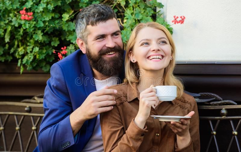 Couple cuddling cafe terrace. Couple in love sit hug cafe terrace enjoy coffee. Pleasant family weekend. Explore cafe. And public places. Married lovely couple stock photography