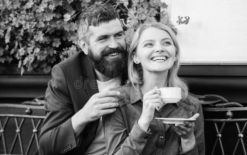 Couple cuddling cafe terrace. Couple in love sit hug cafe terrace enjoy coffee. Pleasant family weekend. Explore cafe royalty free stock photography