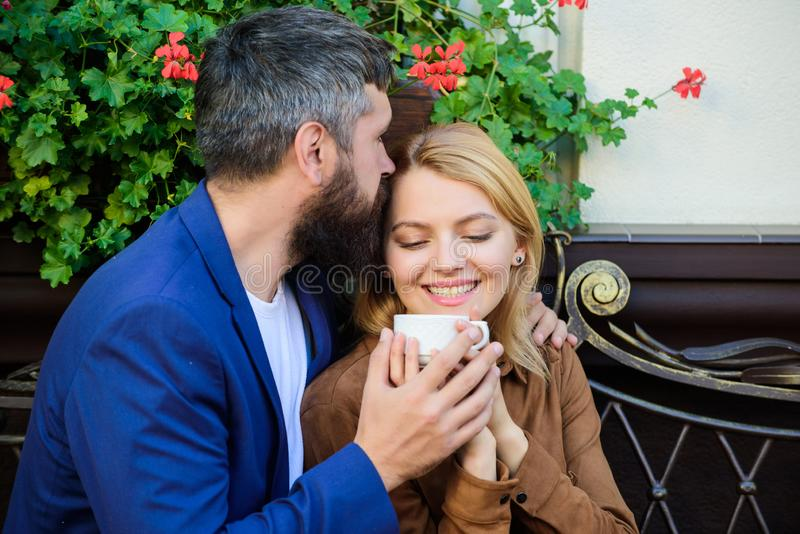 Couple cuddling cafe terrace. Couple in love sit cafe terrace enjoy coffee. Pleasant family weekend. Explore cafe and royalty free stock images