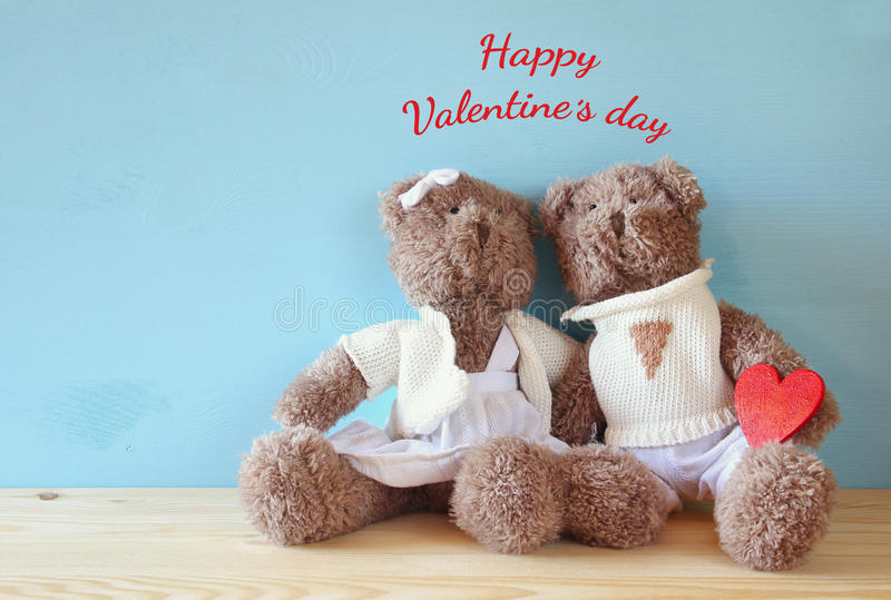 Couple of cute teddy bears holding heart royalty free stock image