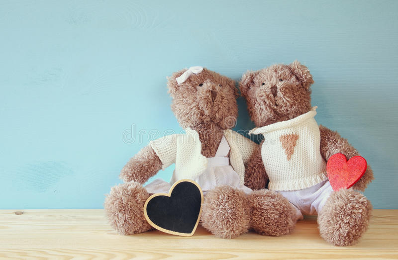 Download Couple Of Cute Teddy Bears Sitting On Wooden Table Stock Photo - Image: 83700867