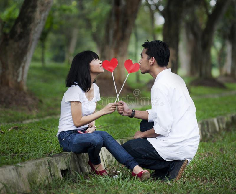 Download Couple with paper hearts stock image. Image of grass - 22823889