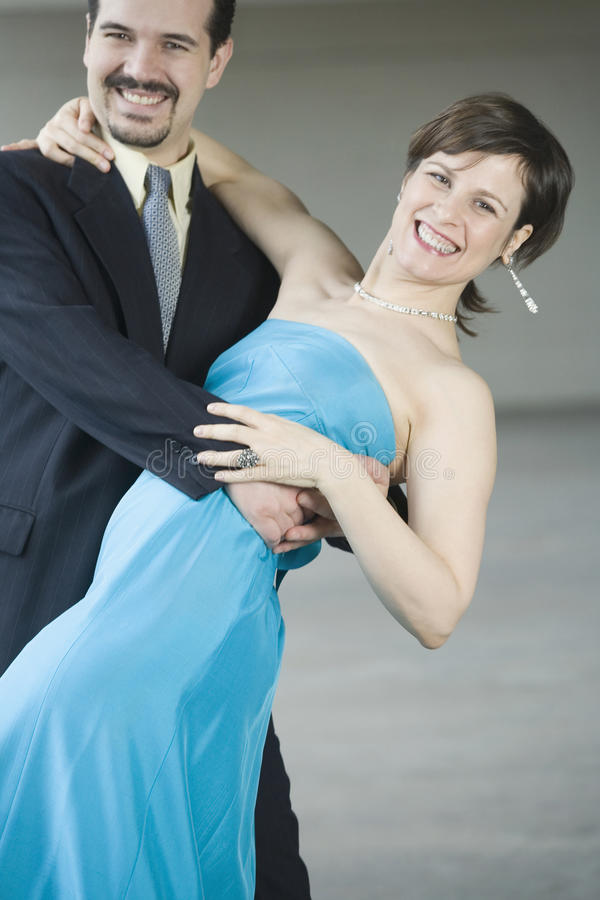 Couple in dance dip. Portrait of a mid adult couple dancing royalty free stock photos