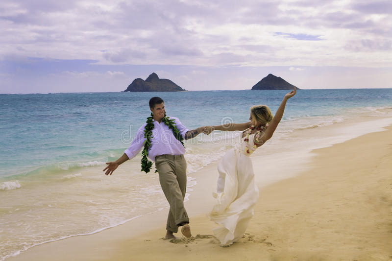 Couple dancing on the beach royalty free stock photography