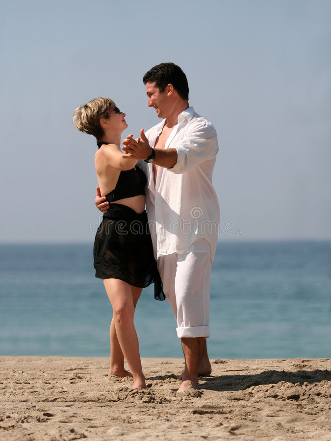 Download Couple Dancing On The Beach Stock Photography - Image: 403642