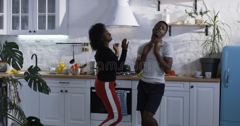 Couple dancing in the kitchen royalty free stock image