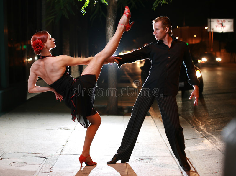 Couple dancing on a street stock images