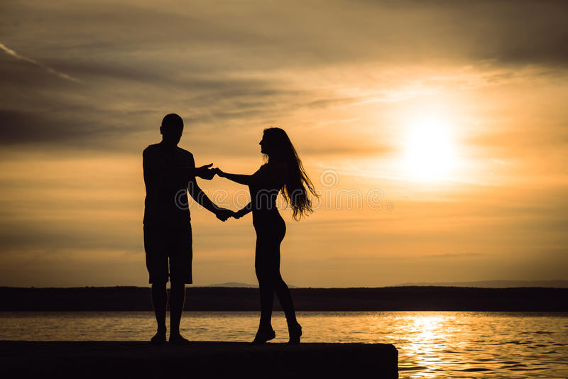 Couple dancing at sunset salsa / brazilian zouk stock photo