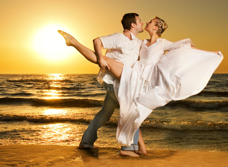 Couple dancing tango on the beach royalty free stock photos