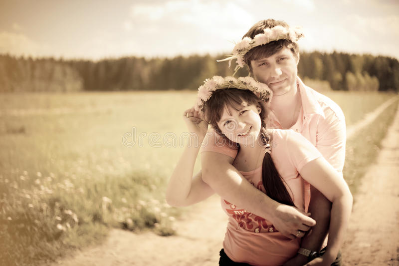 Couple in dandelion wreath stock photos