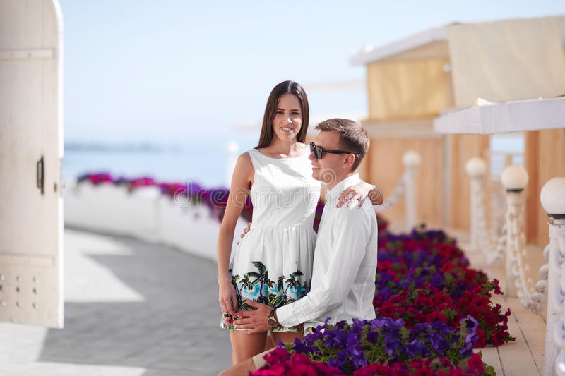 A couple on a date. Beautiful, successful, happy and loving couple. Traveling lovers on a sunny resort background. Copy stock photography