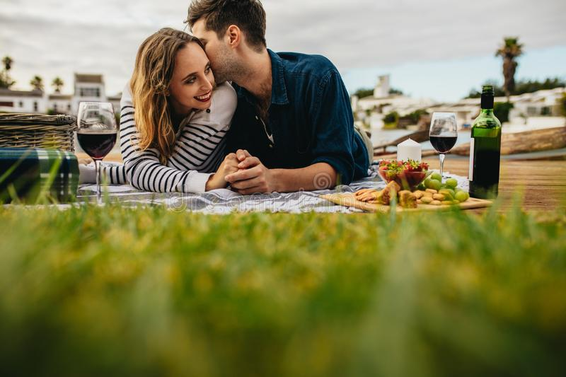 Couple on a romantic date outdoors royalty free stock image