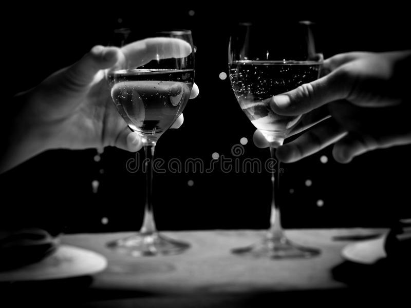 A couple with wine glasses. A couple on a date with wine glasses stock images