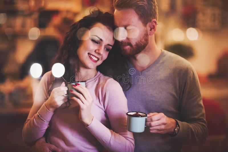 Couple dating in cafe at xmas. Beautiful couple dating in cafe at xmas royalty free stock image