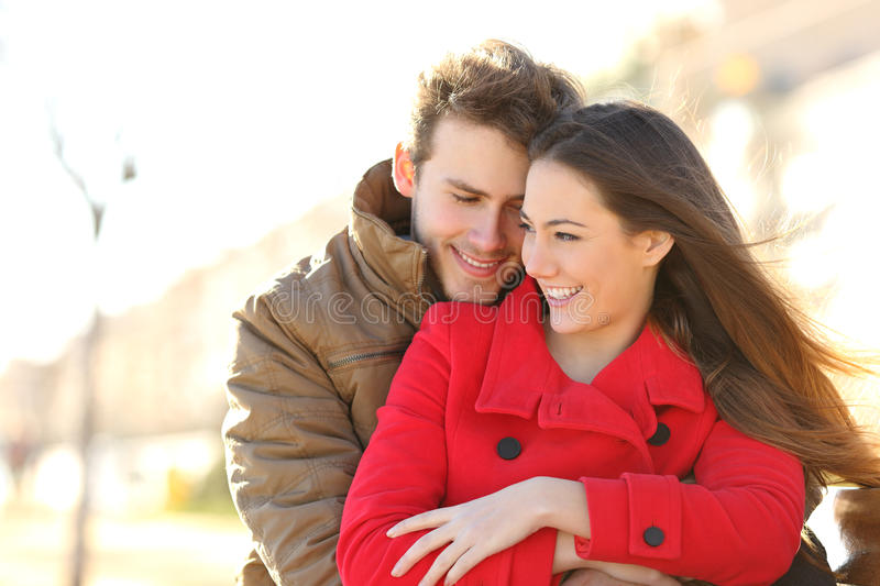 Couple dating and hugging in love in a park royalty free stock photo