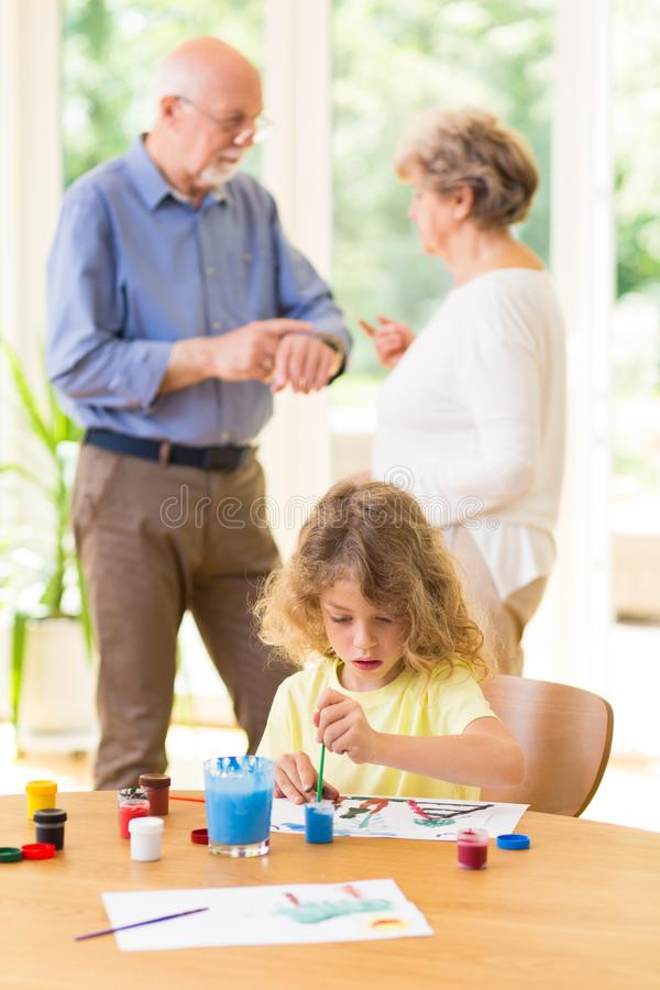 Couple decide who will take care of the grandchild royalty free stock image