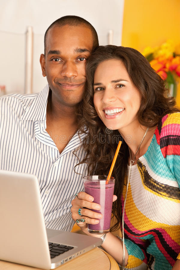 Couple Dining Out Using a Laptop stock image