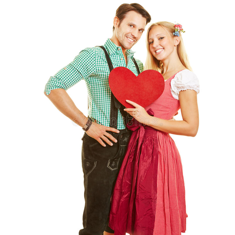 Couple in dirndl and leather pants stock photos