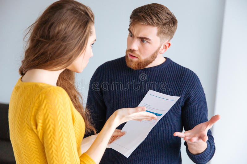 Couple discussing about domestic bills stock images