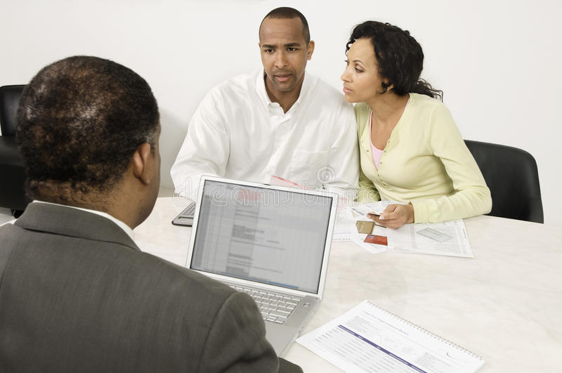 Download Couple Discussing Financial Plans With Male Advisor Stock Image - Image: 29661209