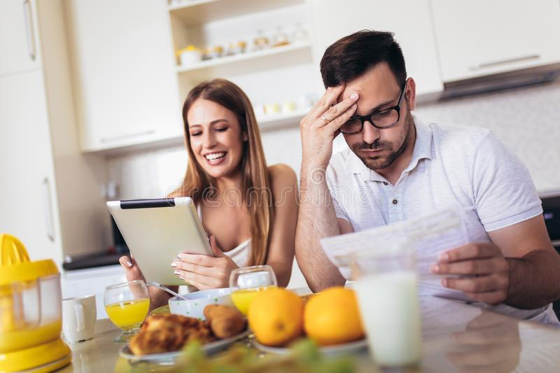 Couple discussing about home budget in the kitchen stock image