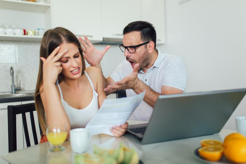 Couple discussing about home budget stock image