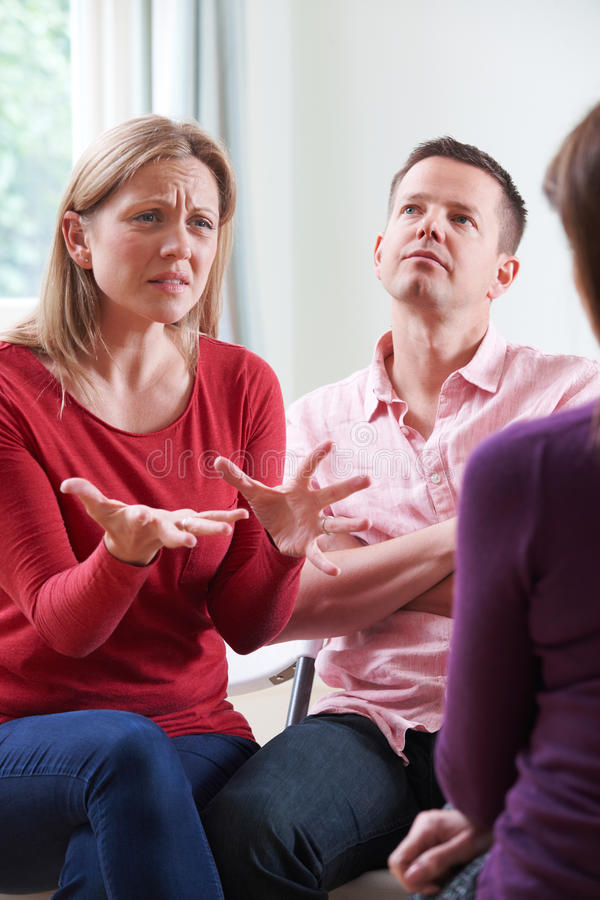 Couple Discussing Problems With Relationship Counsellor. Couple Discuss Problems With Relationship Counsellor stock photo