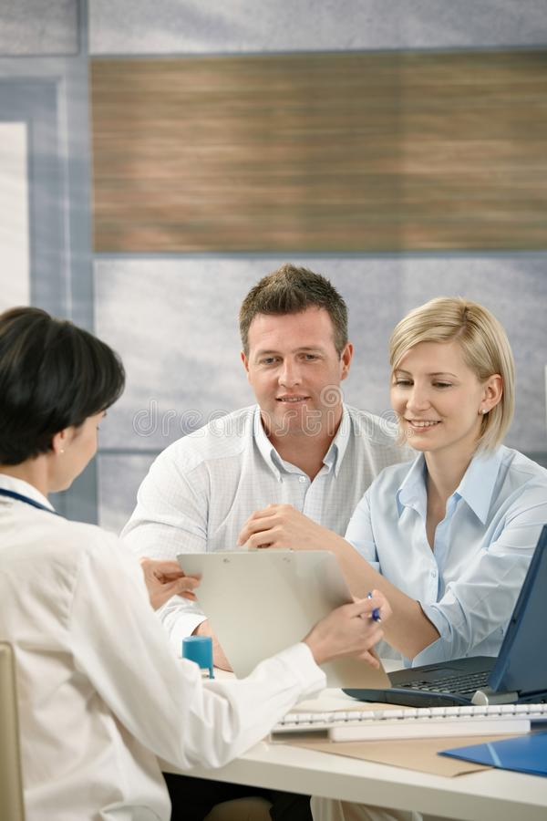 Couple Discussing Results With Physician Royalty Free Stock Photo