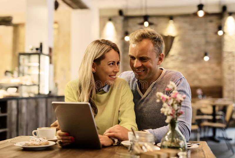 Couple discussing something on digital tablet royalty free stock image