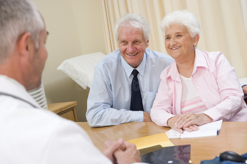 Couple In Doctor S Office Royalty Free Stock Image