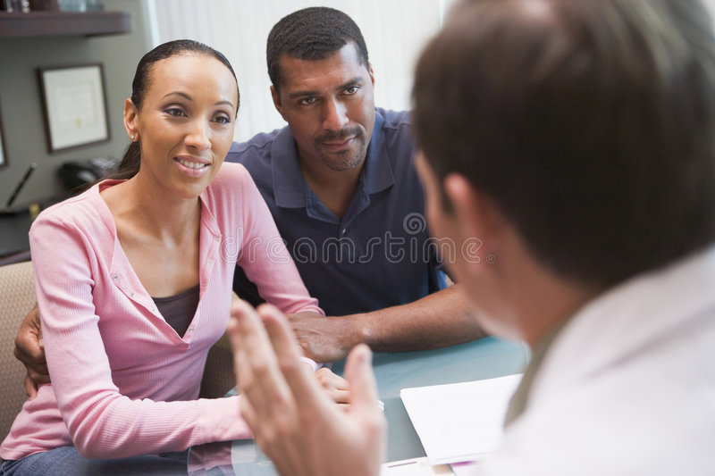 Couple In Doctors Surgery. Couple Attending IVF Consultation in Clinic stock images
