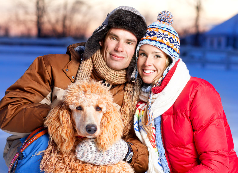 Couple with dog. Young happy smiling couple with dog. Winter