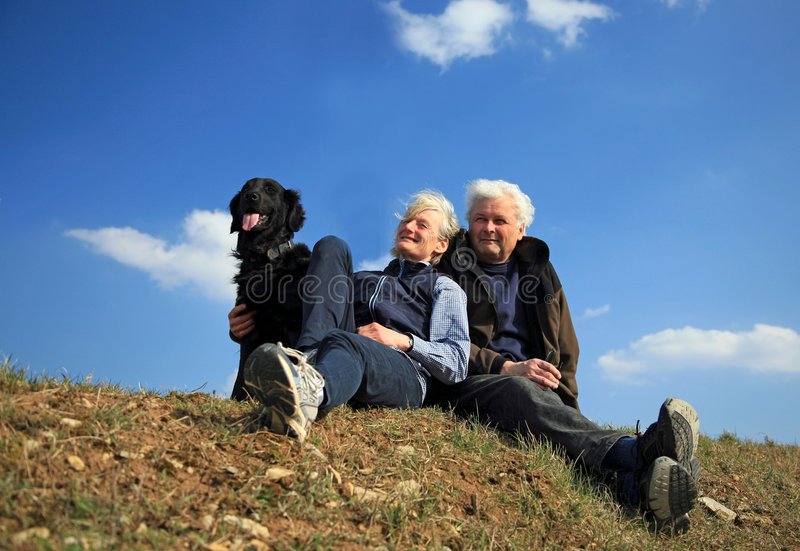 Couple with dog. An elderly married couple taking their dog for a walk