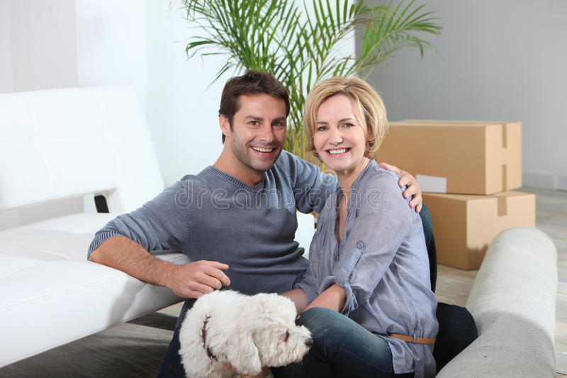 Download Couple And Dog Move Into Home Stock Image - Image: 23697899