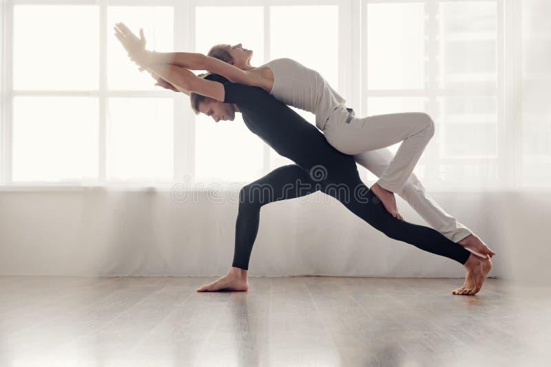Couple doing acro-yoga royalty free stock image