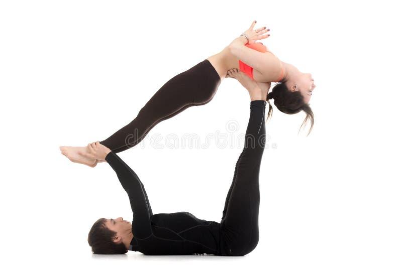 Couple doing acro yoga royalty free stock photography