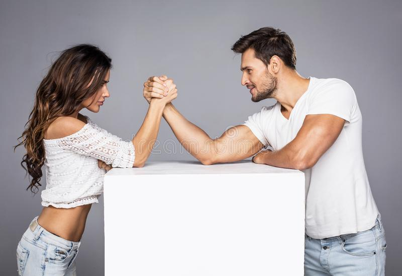 Couple doing arm wrestling challenge stock photos