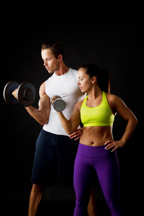 Couple doing dumbbell lifts