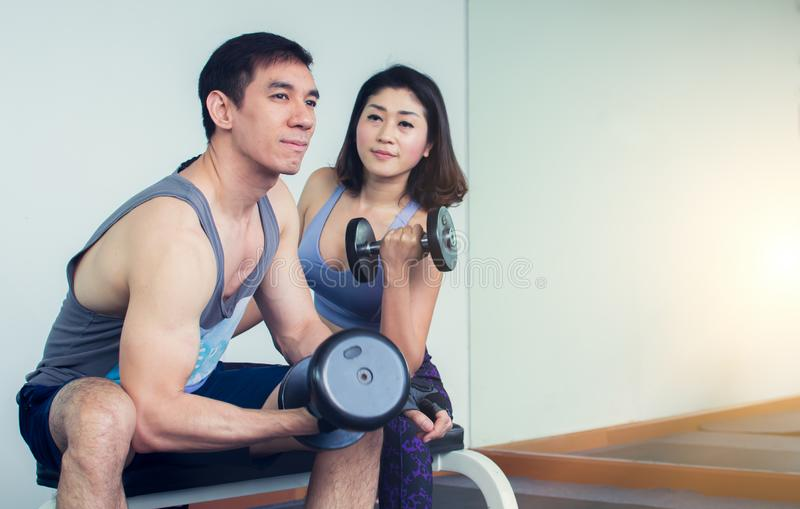 A couple is doing exercise in gym royalty free stock photos