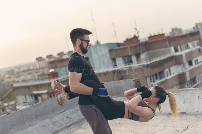 Couple doing hanging crunches exercise stock photography