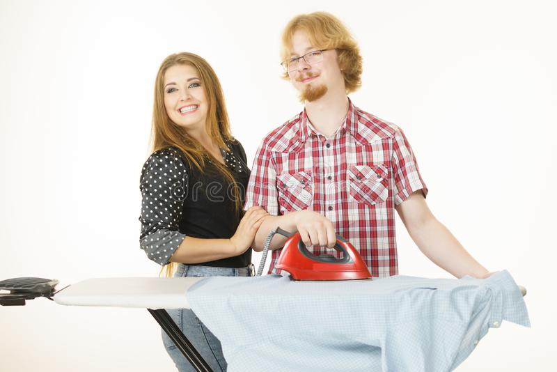 Man and woman couple ironing clothes royalty free stock photos