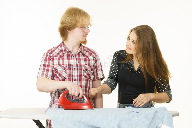 Man and woman couple ironing clothes stock image