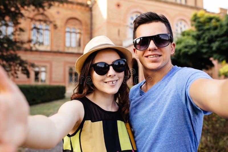 Couple doing selfie. Love Couple doing selfie outdoors stock photos