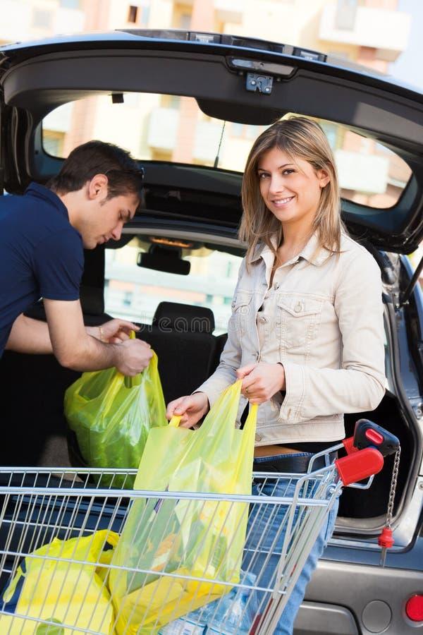 Couple doing shopping stock photos