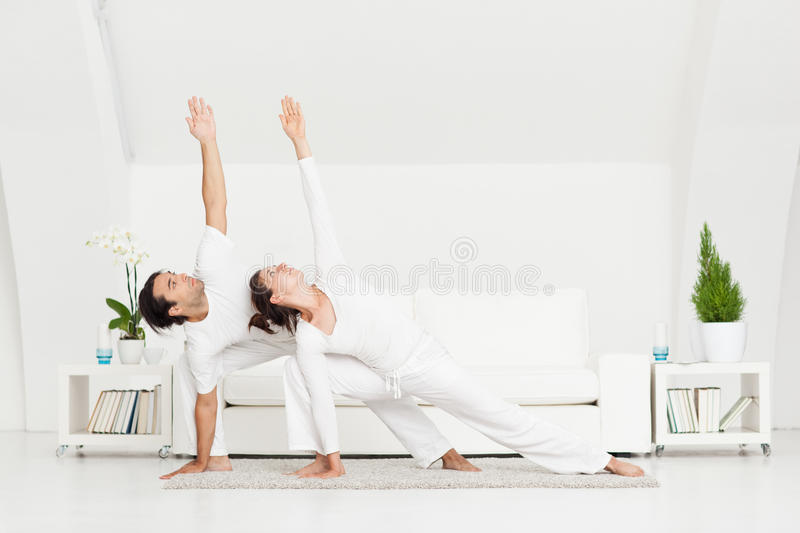 Download Couple Doing Yoga stock photo. Image of adult, arms, flexibility - 30978406