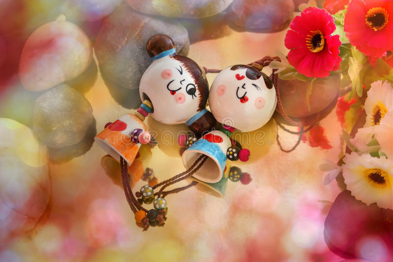 couple dolls in love story concept with pink bokeh stock image