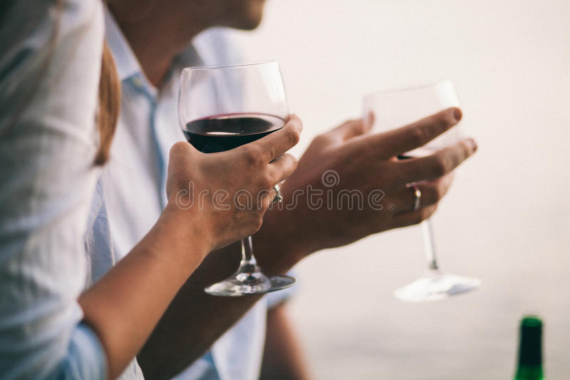 Couple drink wine at sunset beach. Montenegro royalty free stock image