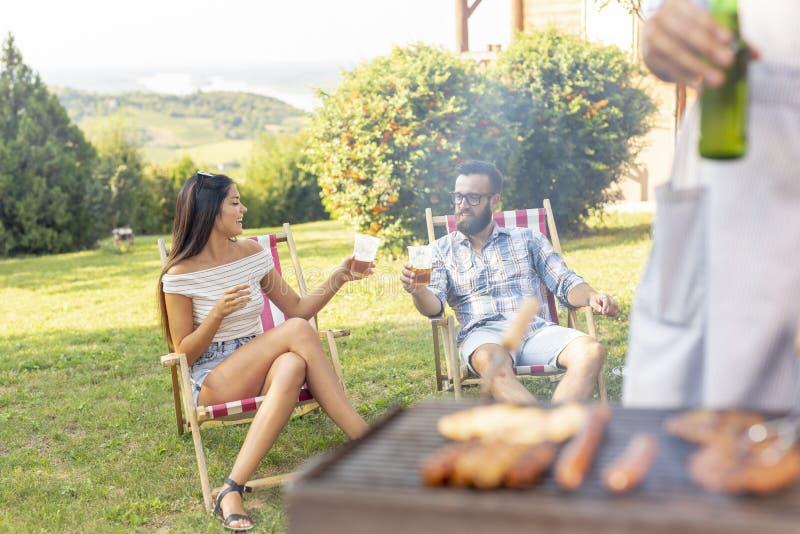 Couple at a barbecue party stock photos