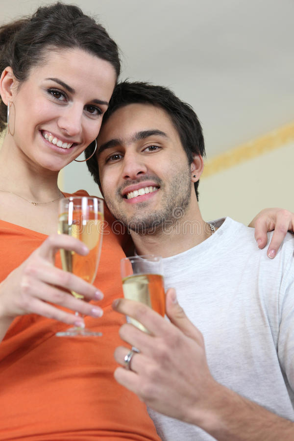 Couple Drinking A Celebratory Drink Royalty Free Stock Photos
