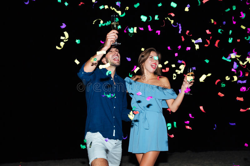 Couple drinking champagne and celebrating at night stock photos